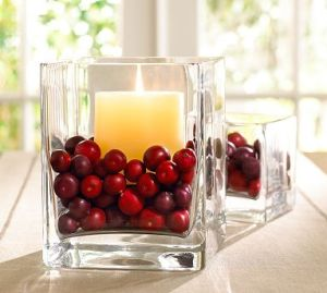 simple decoration with candle and cranberries